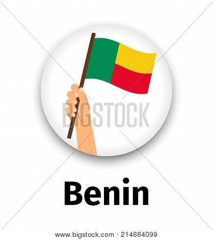 Benin flag in hand, round icon with shadow isolated on white. Human hand holding flag, vector illustration