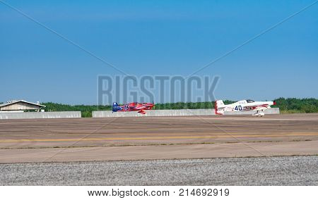 RAYONG THAILAND-NOVEMBER 18 2017 : Ryszard Zadow's plane no.15 and Chip Mapoles's plane no.40 take off in Air Race 1 World Cup Thailand 2017 at U-Tapao Naval Air Base in Thailand