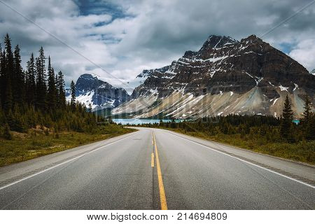 Scenic Icefields Pkwy in Banff National Park leading to the Bow Lake. It travels through Banff and Jasper National Parks and offers spectacular views of the Rocky mountains.
