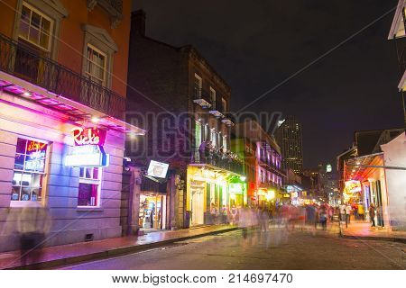 NEW ORLEANS - JUN. 1, 2017: Historic Buildings on Bourbon Street between Toulouse Street and St Louis Street in French Quarter at night in New Orleans, Louisiana, USA.