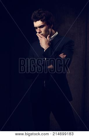 Thinking Depression Charismatic Man Looking Down On Dark Shadow Dramatic Light Background. Closeup P