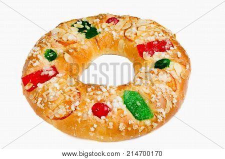 King cake or Roscon de Reyes on white background. Spanish typical dessert of Epiphany
