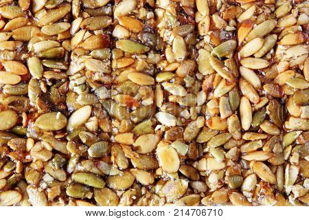 sweet nuts and honey bar , close up as background