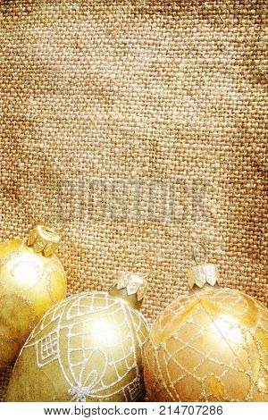 golden xmas toys on burlap . image in vintage grunge style
