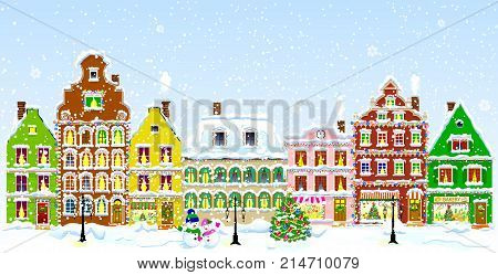 City street in winter. Christmas Eve. The winter vacation. The houses are covered with snow. Snow on a city street. Houses decorated before the winter holidays.