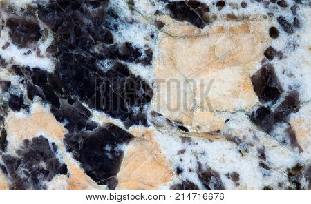 Plagioclase feldspar silicate mica mineral stones texture pattern macro view. Beautiful natural stony background.