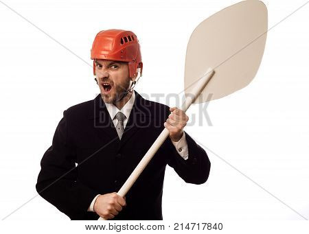 Dissatisfied Businessman In A Hockey Helmet And With An Oar In His Hands