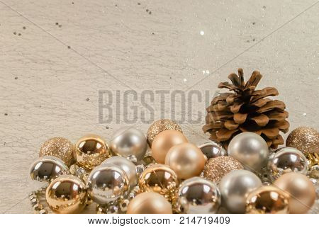 Deocration for christmas season with mix ball in gold with gilter, gol simple, silver ,candle in big size and star form decoration with fruit pine and silver necklace, white background.