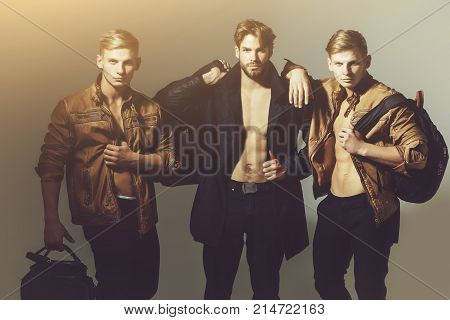 Muscular Macho Men With Sexy Body Holds Bag, Suitcase, Backpack