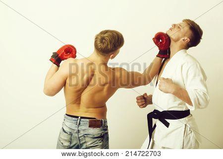 Boxer Punching Young Karate Athlete