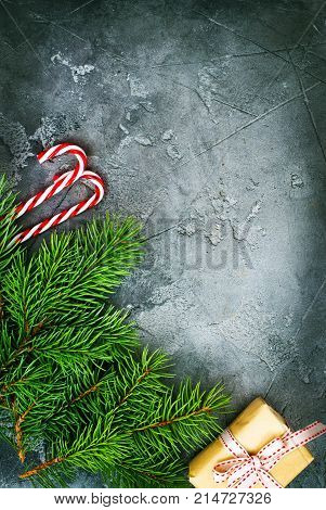 Fir tree branches and Christmas decorations are a table. Christmas background.