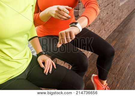 Friends Looking At Smart Watch Or Fitness Tracker