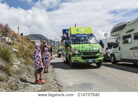 Col de la Croix de Fer France - 25 July 2015: Kid in Polka-Dot Jersey enjoying the passing of the Publicity Caravan on the road to the Col de la Croix de Fer in Alps during the stage 20 of Le Tour de France 2015. ERDF is a major French power company.