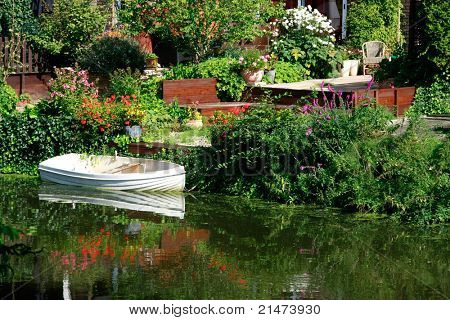 Dutch flower garden with boat on a canal (Amsterdam)