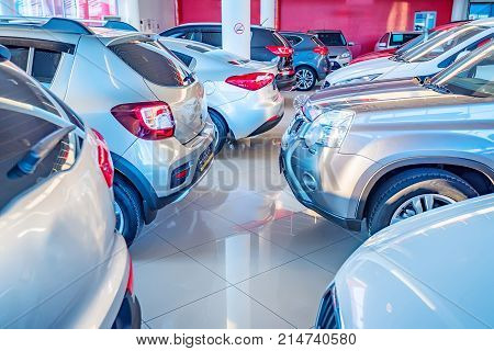Stock of cars in showroom of automobile dealer poster