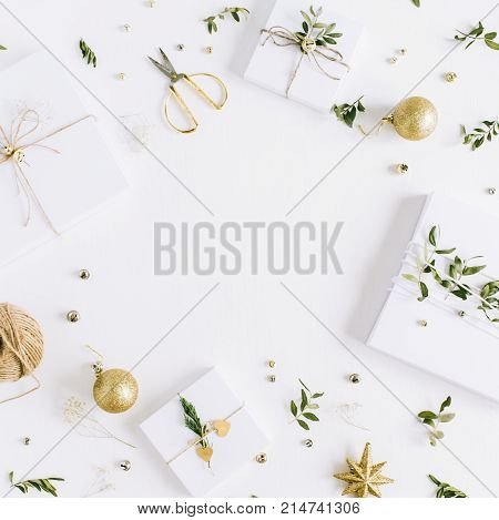 Frame of handmade Christmas gift boxes and festive decoration on white background. Flat lay top view holiday composition.
