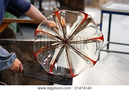 Glass blower forming a piece of decorative glass. (Murano, Italy)
