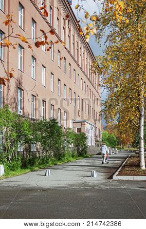Apatity Russia - September 14 2012: Geological Institute and a small walkway in front of him in the city of Apatity. Autumn here comes early