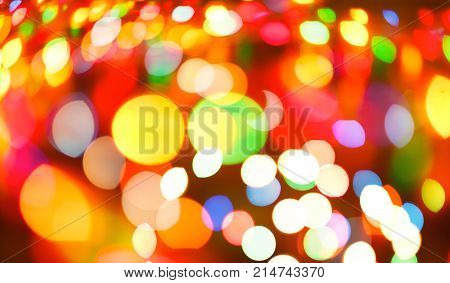 Colorful light blurred background, unfocused. Christmas or other holiday decorations, garland illumination bokeh.