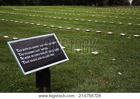 Gettysburg, Pennsylvania - September 9, 2009 - Wide view of a plaque commemorating the Unknown Soldier in front of lines of numbered stones in a field in Gettysburg National Cemetery, Pennsylvania on a cloudy afternoon in September.