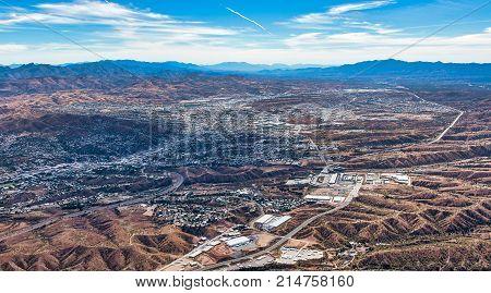Border Wall aerial view looking into Nogales Mexico from Nogales Arizona USA