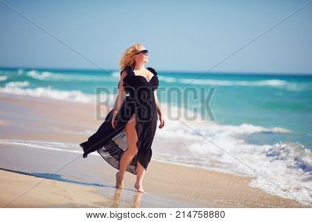 Body Positive, Plus Size Woman Enjoys Summer Day At The Beach