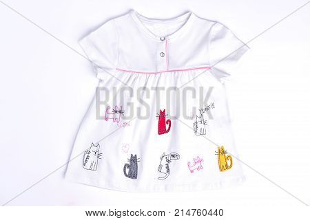 Newborn girl cotton natural dress. Baby-girl cats print dress isolated on white background. Infant girl adorable summer dress.