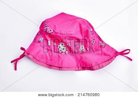 Baby-girl summer pink panama isolated. Infant baby-girl cute pink summer headgear isolated on white background. Kids brand summer headwear.