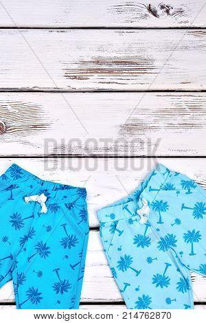 Set of kids fashion summer trousers. Kids brand patterned harems, copy space. Kids blue cotton pants.