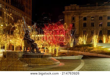 Statue (created in 1916) of historic Mayor Tom Johnson amid Christmas lights on Cleveland's Public Square