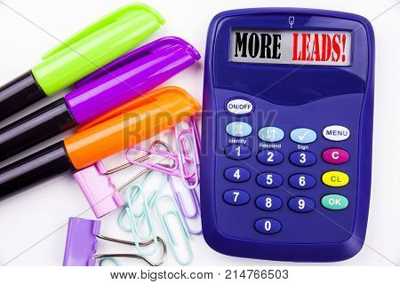 Writing Word More Leads Text In The Office With Surroundings Such As Marker, Pen Writing On Calculat