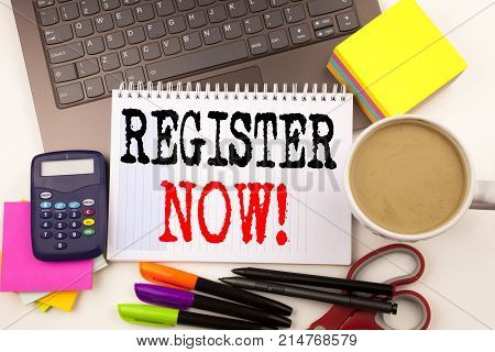 Word Writing Register Now In The Office With Surroundings Such As Laptop, Marker, Pen, Stationery, C
