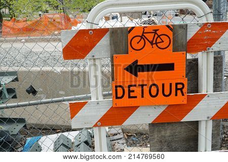 bicycle detour sign on road block sign