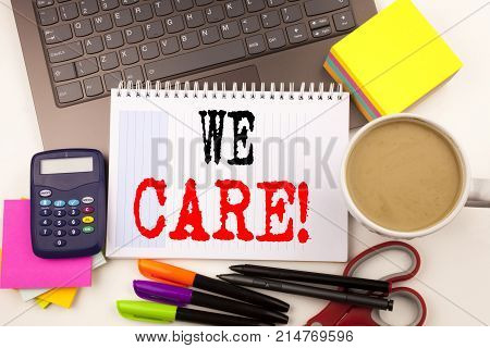 Word Writing We Care In The Office With Surroundings Such As Laptop, Marker, Pen, Stationery, Coffee