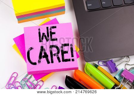 Writing Text Showing We Care Made In The Office With Surroundings Such As Laptop, Marker, Pen. Busin