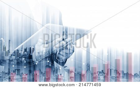 Double exposure Businessman working on digital tablet with modern buildings. Business growth and investment concept