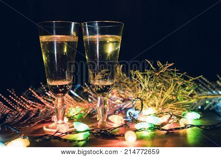 Two Glasses With Champagne On A Wooden Table Decorated