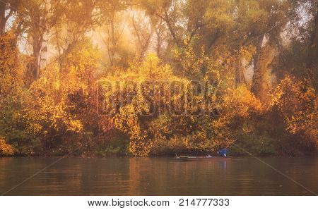 Vibrant Colored Photo Of A Fisher On The River