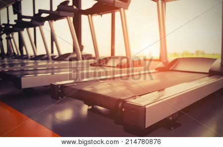 Exercise treadmill cardio running workout at fitness gym for taking weight loss with machine aerobic for slim and firm healthy in the morning.