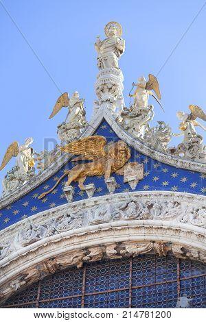 St Mark's Basilica (Basilica di San Marco) Lion of Venice on the top St Mark's Square Venice Italy. It is Roman Catholic church Italo-Byzantine architecture located on St Mark's Square