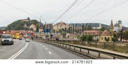 Sighisoara Romania October 08 2017 : View of the old town of Sighisoara from the central highway passing through the city. Sighisoara Romania