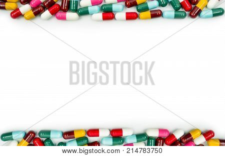 Colorful of antibiotic capsules pills isolated on white background with copy space. Drug resistance concept. Antibiotics drug use with reasonable and global healthcare concept. poster
