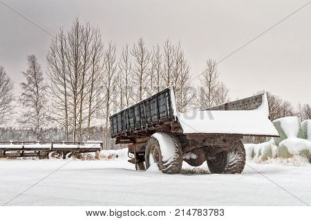 The snow fell over the fields very suddenly this year. The farming machinery were covered with heaps of snow in the Northern Finland.