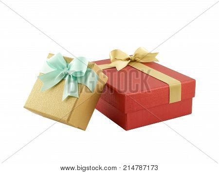 close-up two gift boxes (yellow gold box with mint green ribbon bow and red box with golden ribbon bow) isolated on white background
