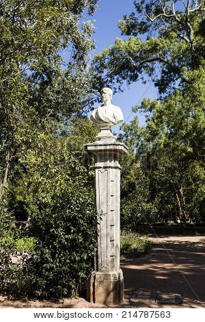 OEIRAS, PORTUGAL - September 17, 2017: Bust statues of poets philosophers and writers decorating the gardens of the Palace of Marques de Pombal in Oeiras Portugal