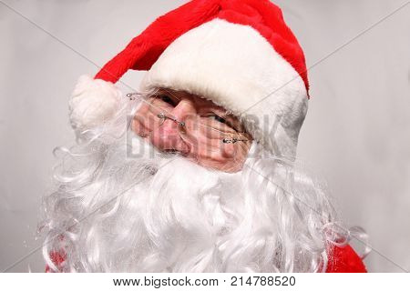 Santa Claus makes funny faces in a FISHEYE Lens. Funny Santa Claus Photos.