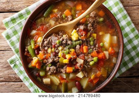 Delicious Hamburger Soup With Ground Beef And Mix Of Vegetables Close-up. Horizontal Top View