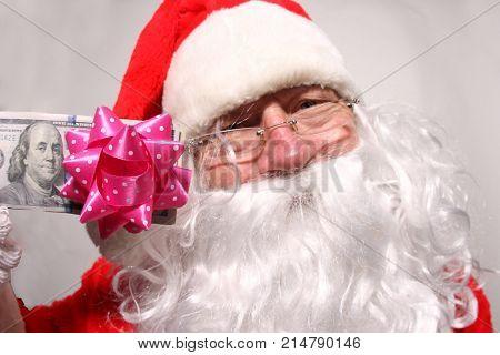 Santa Money. Christmas Cash. Santa has cash for Christmas.