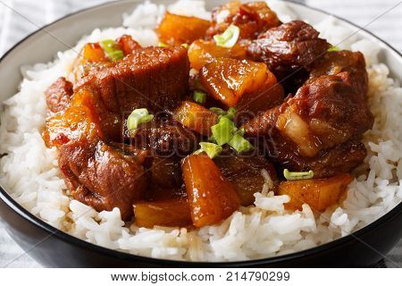Filipino Festive Meal: Hamonado Pork With Pineapple And Garnish Of Rice Close-up. Horizontal