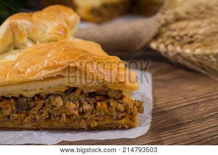 Sliced succulent meat pie with mushrooms and meat.